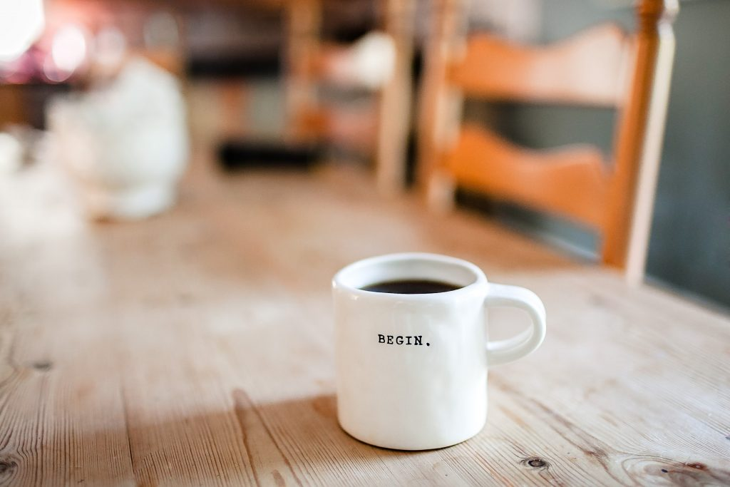 "Psychotherapy psychology geneva - image of a coffee mug on a table with ""begin"" written on it."